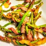 bacon wrapped asparagus on a plate