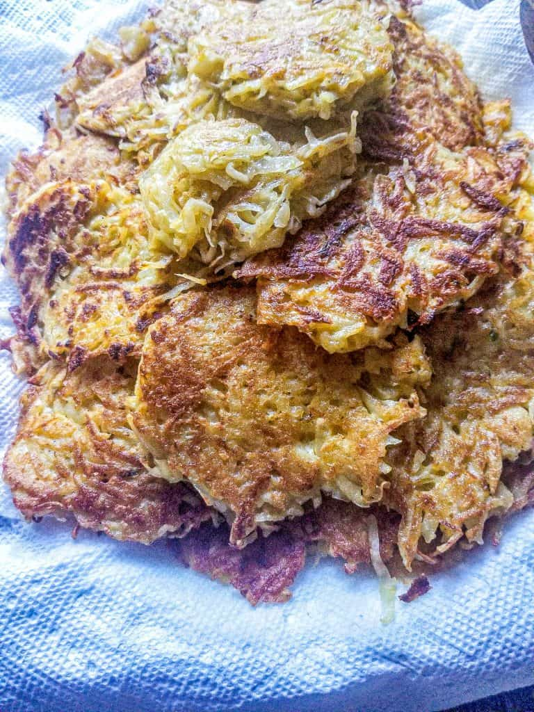 cheesy hasbrowns stacked on a plate